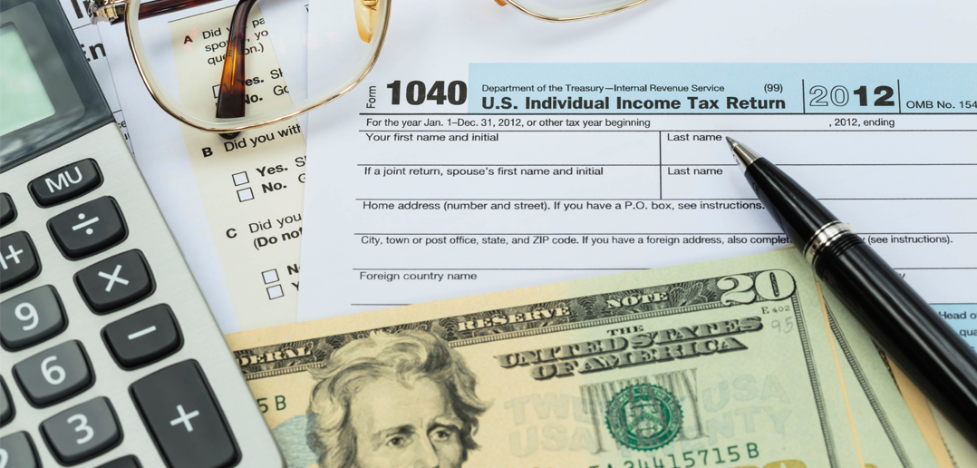 Tax form, calculator and money