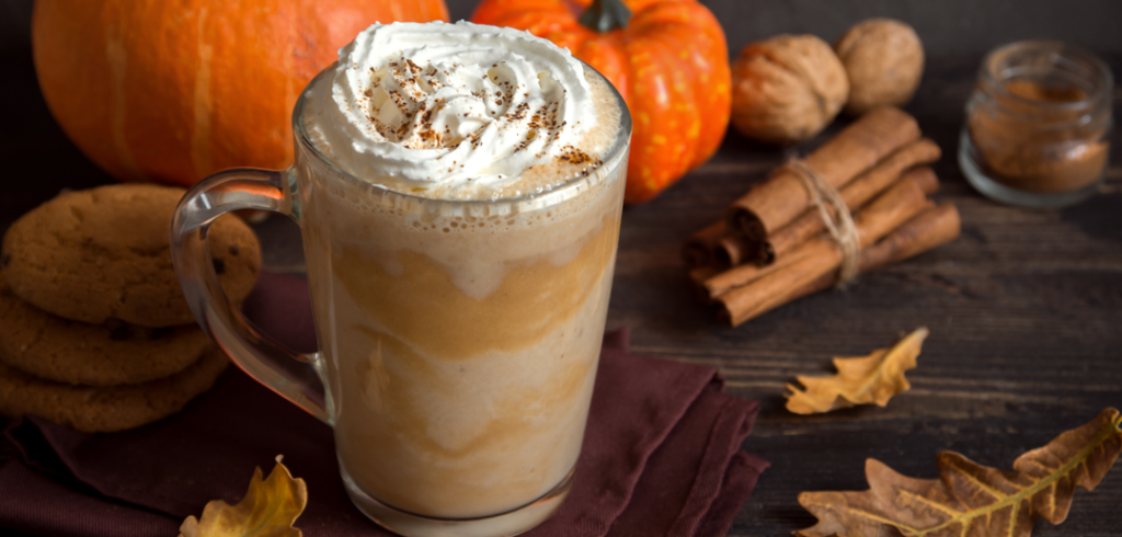 A picture of a pumpkin spice hot latte.