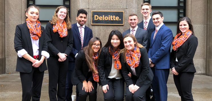 Students outside of Deloitte