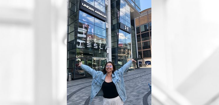 Student Rebecca Shepard standing outside an Under Armor store where she completed her internship