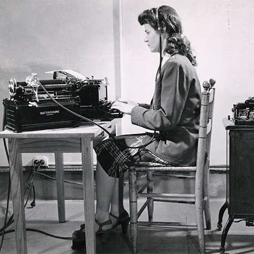 specialized program student learns using business machines in 1945