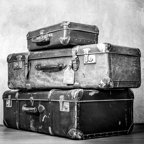 a stack of old suitcases
