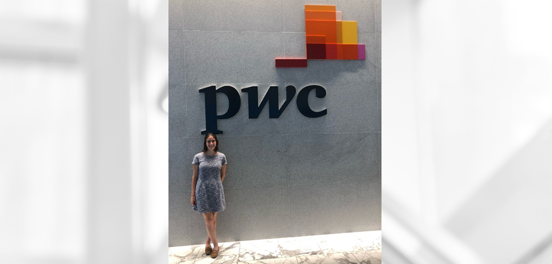Student standing in front of PwC sign during her internship experience