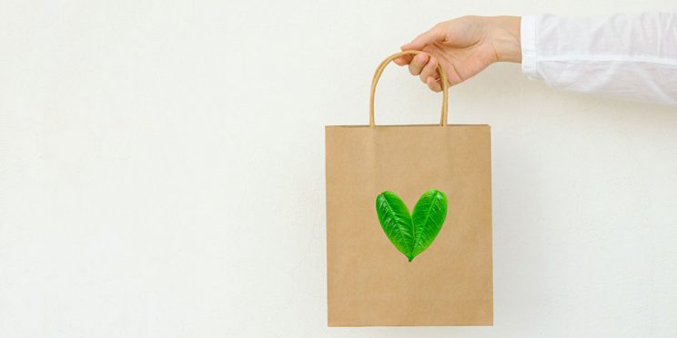 Shopping bag with green leaves