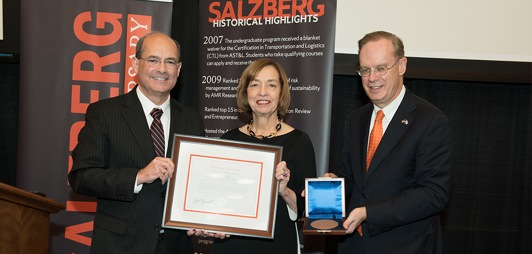 photo of Gary LaPoint and Kent Syverud presenting Ann Drake with an award