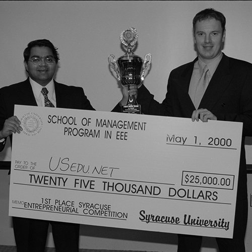 Winners of the first entrepreneurial competition pose with their check