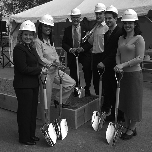 Group posing with shovels during the groundbreaking