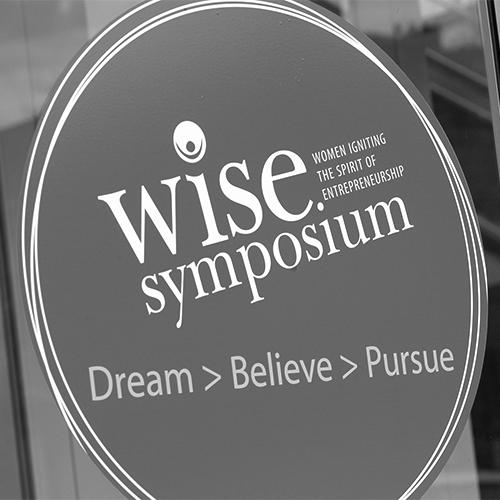 WISE symposium sign