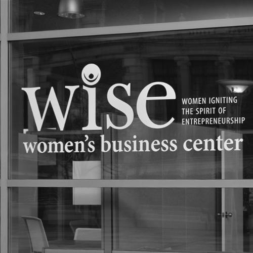 WISE Women's business center door sign