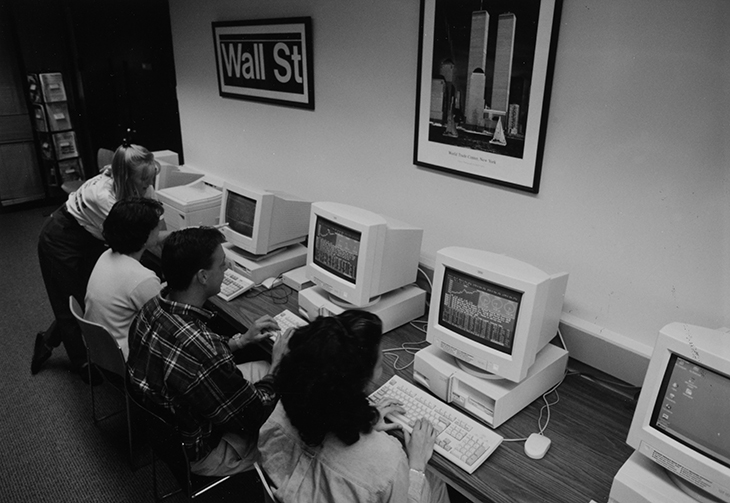 Students sit in front of computers