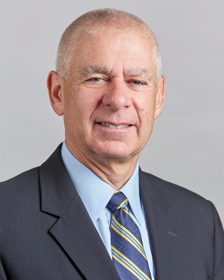 headshot of DONALD P. FAVRE