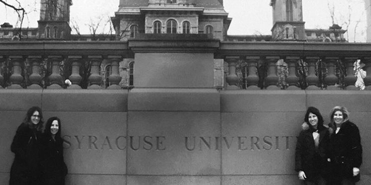 orange family legacy photo of four sisters standing by the Syracuse University sign