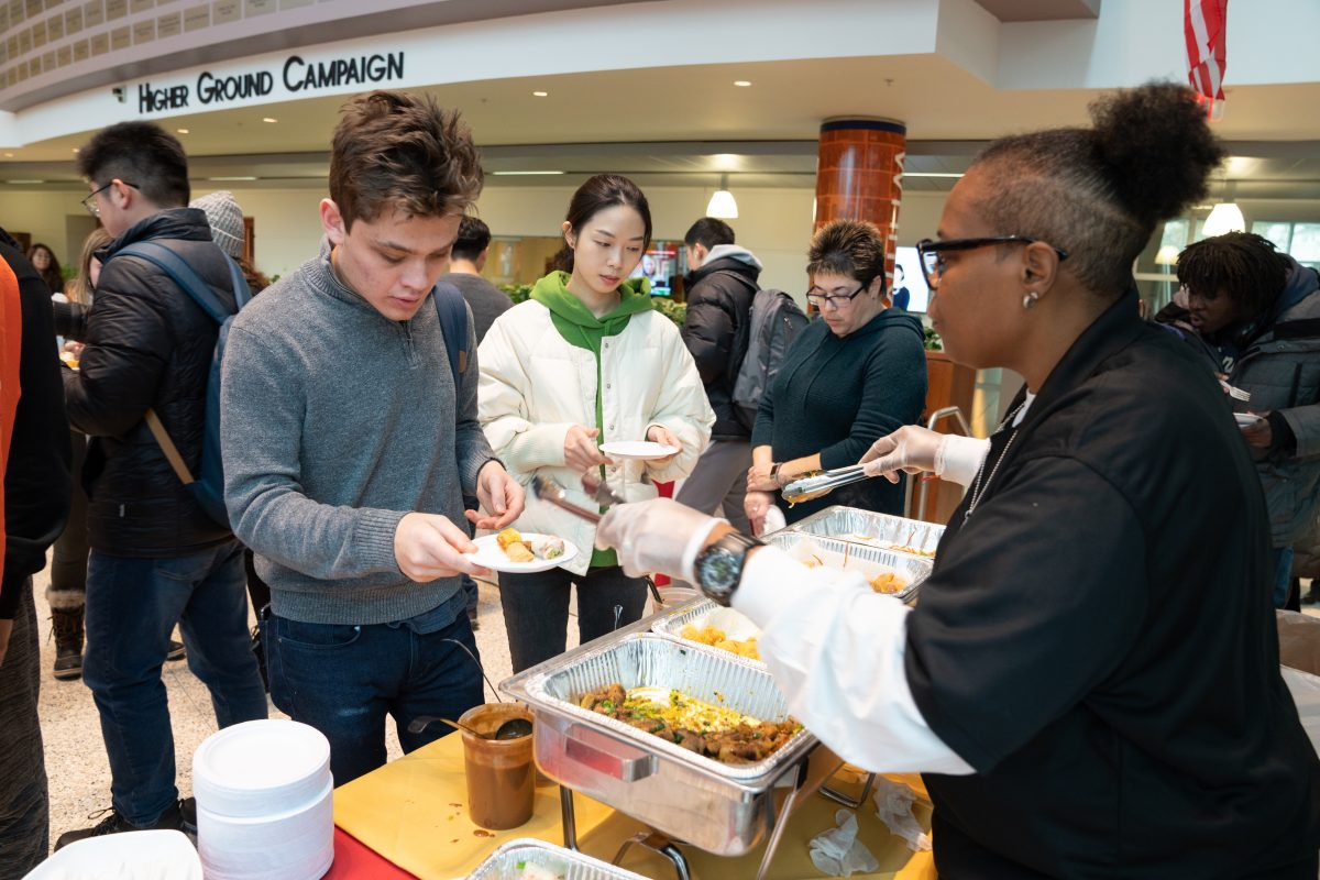 students being served international food
