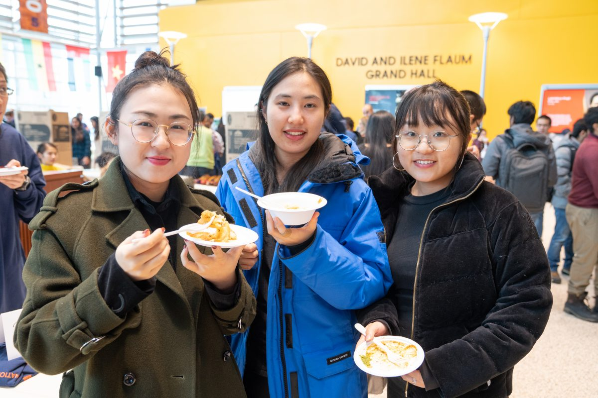 students posing for a photo eating food