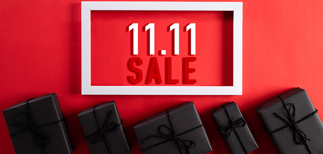 11.11 sale sign and wrapped gifts