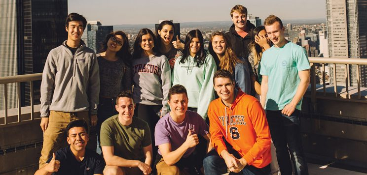 students posing for photo on top of The Epic in NYC