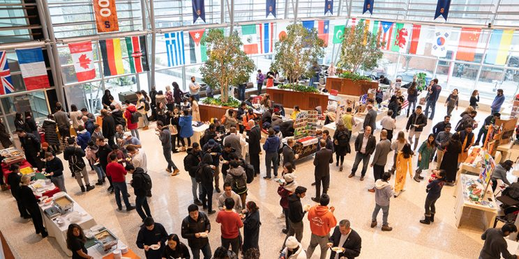image of people in Flaum Grand Hall during the International Week cultural expo