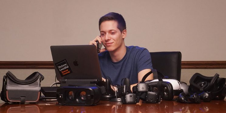 photo of Matt Shumer on the computer with multiple VR headsets around him