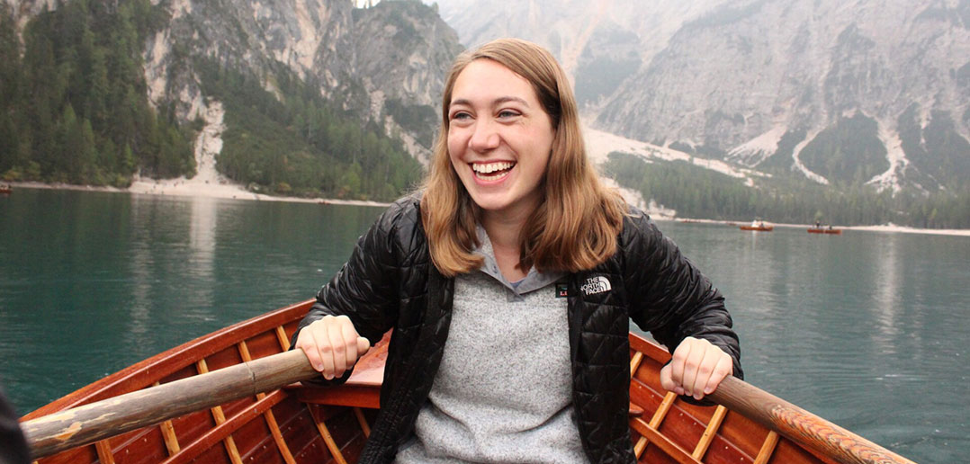 Adena Rochelson rowing a boat through the mountains