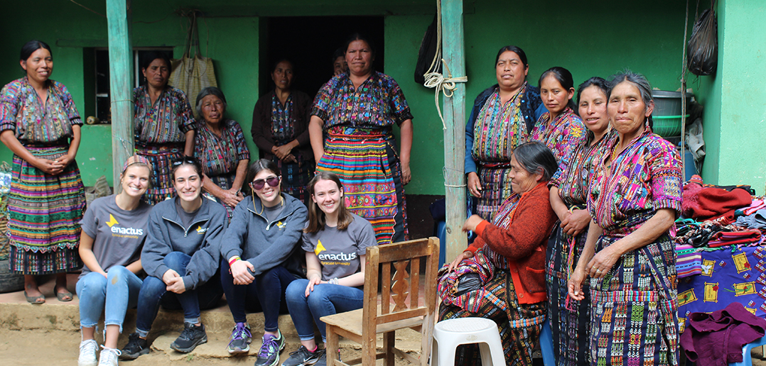 students and village members pose for a photo in guatemala