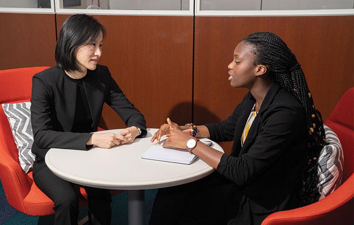 Professor Li meeting with student
