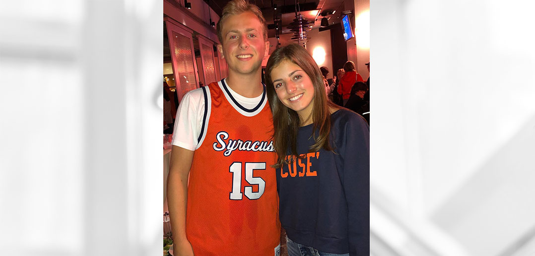 Jack and Kate Adler posing in Syracuse University apparel
