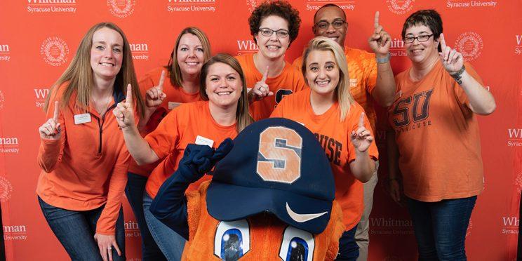 Whitman Career Center team posing with Otto the Orange