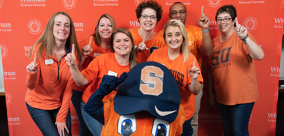 Whitman Career Center team posing with Otto the Orange