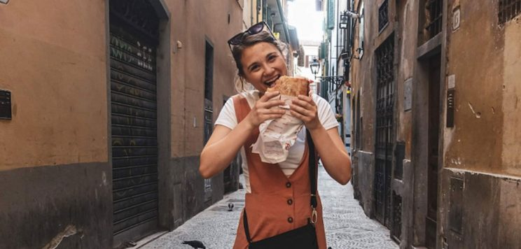 Brittany Loper eating a sandwich in Florence