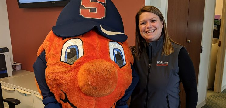 Emily Shaughnessy posing with Otto in the Whitman Career Center
