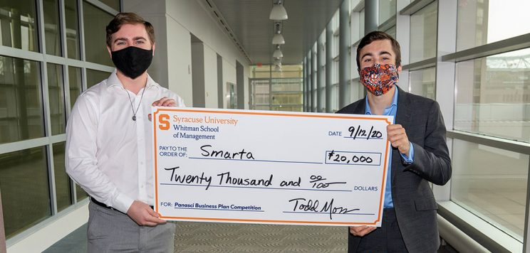 first place winners, Nick Barba and David Fox, pose with a large check